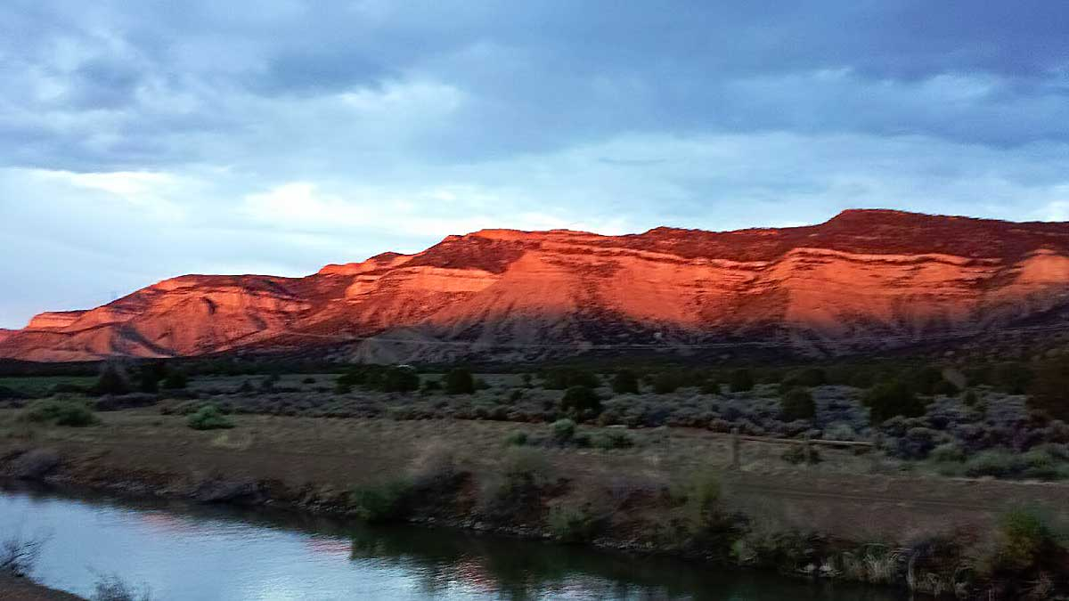 A red glow descends on the surrounding foothills at Grizzly Roadhouse B&B and Vacation Rentals
